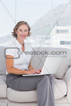 Attractive businesswoman using laptop