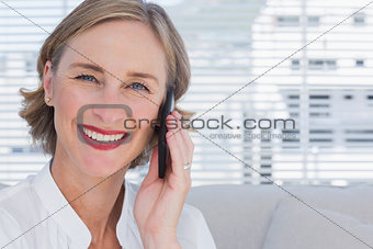 Portrait of businesswoman calling