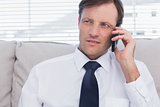Attractive businessman calling