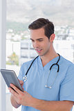 Male nurse working on a tablet pc