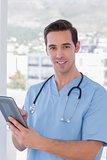 Male nurse holding a tablet pc