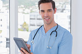 Male nurse holding a digital tablet