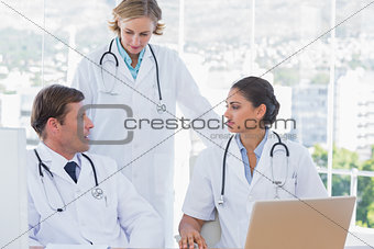 Group of doctors discussing and working together