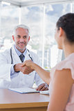 Patient shaking hands to doctor
