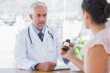 Patient holding jar of medicine