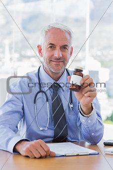 Attractive doctor holding medicine jar