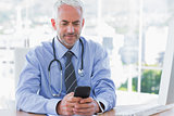 Doctor using his smartphone