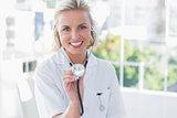 Radiant nurse showing her stethoscope