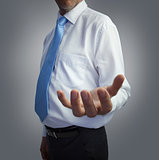 Businessman presenting his empty hand