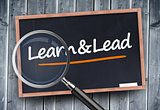Learn and lead written on a blackboard