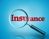 Magnifying glass revealing the word insurance written in red