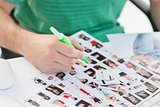Photo editor marking contact photographs