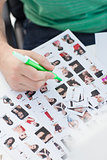 Photo editor marking photographs of contact