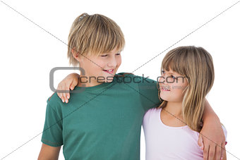 Little boy and girl looking each other and smiling