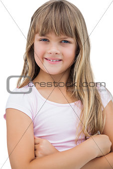 Beautiful little girl smiling with her arms crossed