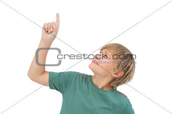Boy raising his finger and looking up