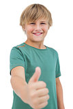Happy little boy giving thumbs up