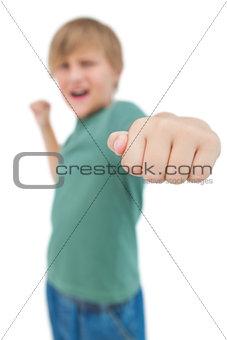 Blonde boy punching