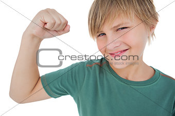 Little boy tensing arm muscle