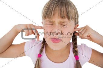 Little girl clogging her ears