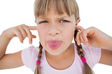 Little girl clogging her ears and wincing