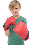 Furious blonde boy with boxing gloves