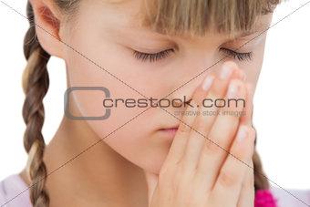 Little blonde girl praying