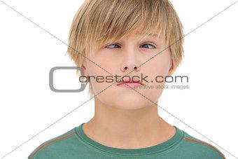 Little boy wincing
