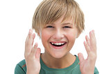 Suprised blonde boy with hands up smiling