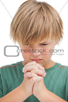 Little boy saying his prayers