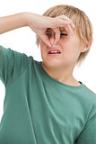 Boy pinching his nose