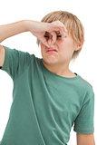 Dsigusted boy pinching his nose