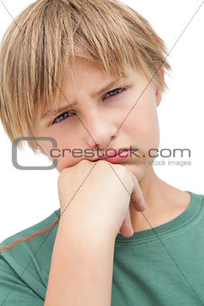 Little boy thinking about something