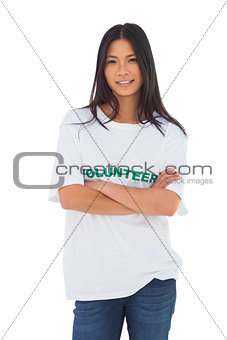 Attractive volunteer with arms crossed
