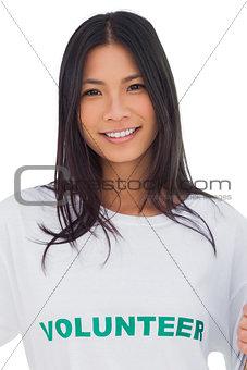 Portrait of an attractive woman wearing volunteer tshirt