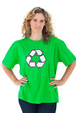 Environmental activist wearing green shirt with recycling symbol on it