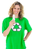 Environmental activist holding a light bulb
