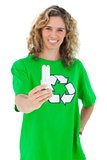 Cheerful environmental activist holding a light bulb