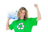 Cheerful environmental activist holding box of recyclables