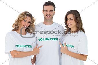 Group of volunteers pointing their tshirt