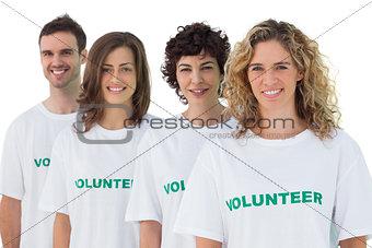 Four people wearing volunteer tshirt