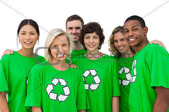 Group of smiling activists wearing green shirt with recycling symbol on it