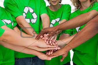 Group of environmental activists putting hands together