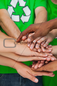 Activists piling up their hands together