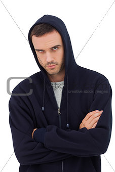 Attractive man with arms crossed looking angry