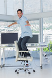 Creative designer surfing his swivel chair