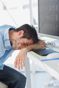 Graphic designer sleeping on his keyboard