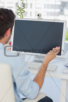 Designer having a video chat in his office