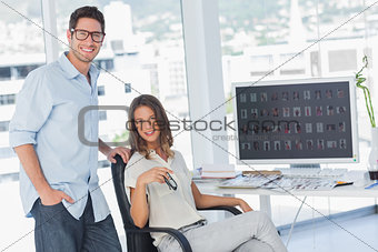 Attractive photo editors posing in their office