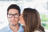 Attractive designer giving a kiss to a colleague